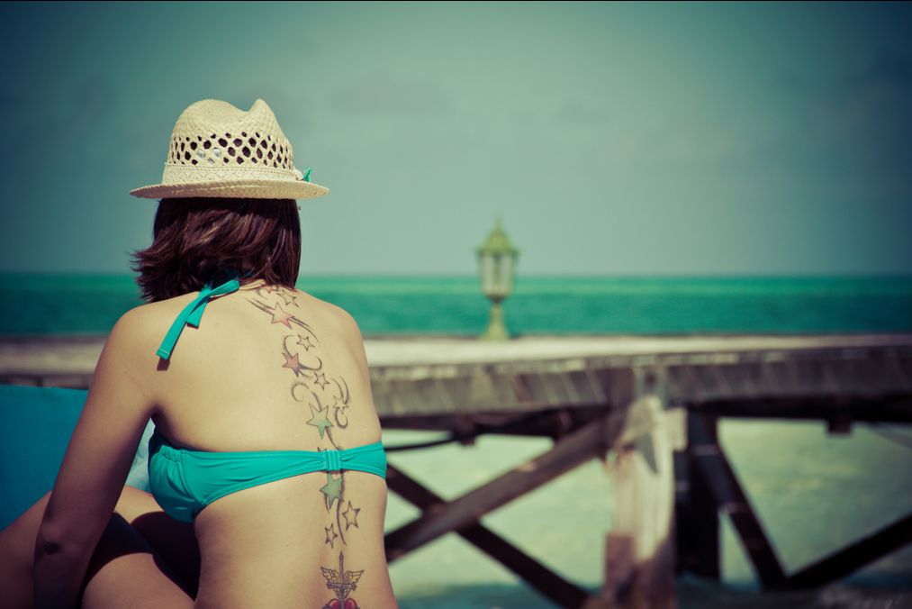 Girl with tattoo on beach