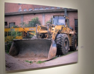 Liu Bolin hiding in construction equipment