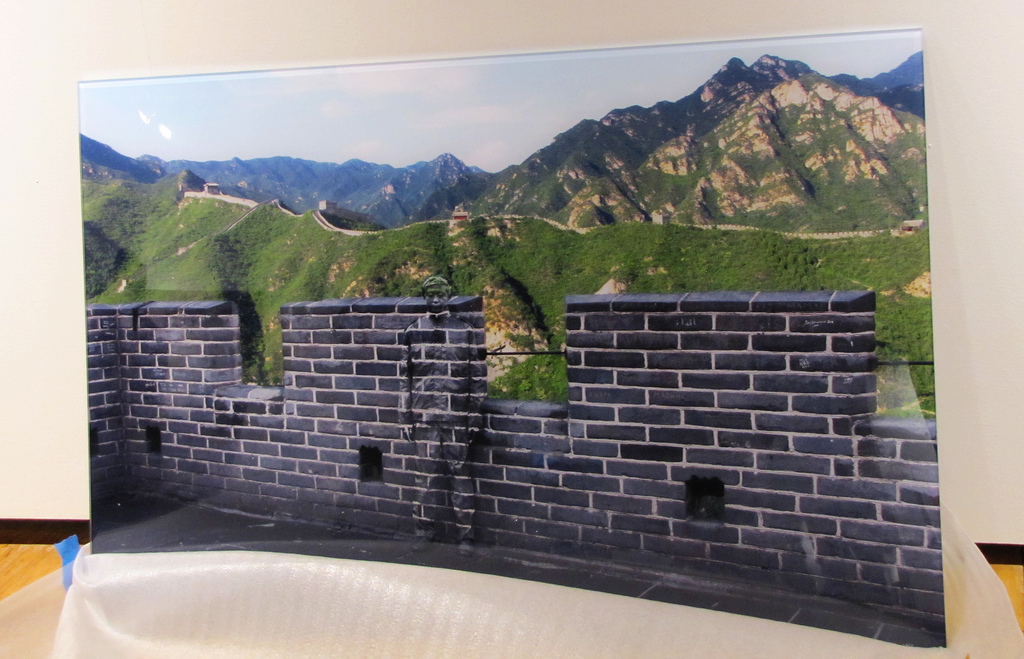 Liu Bolin atop the Great Wall