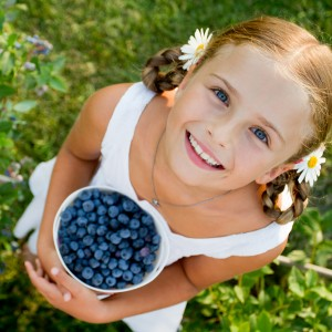 girl with fresh blueberries
