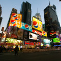 The screens of Times Square shine bright.