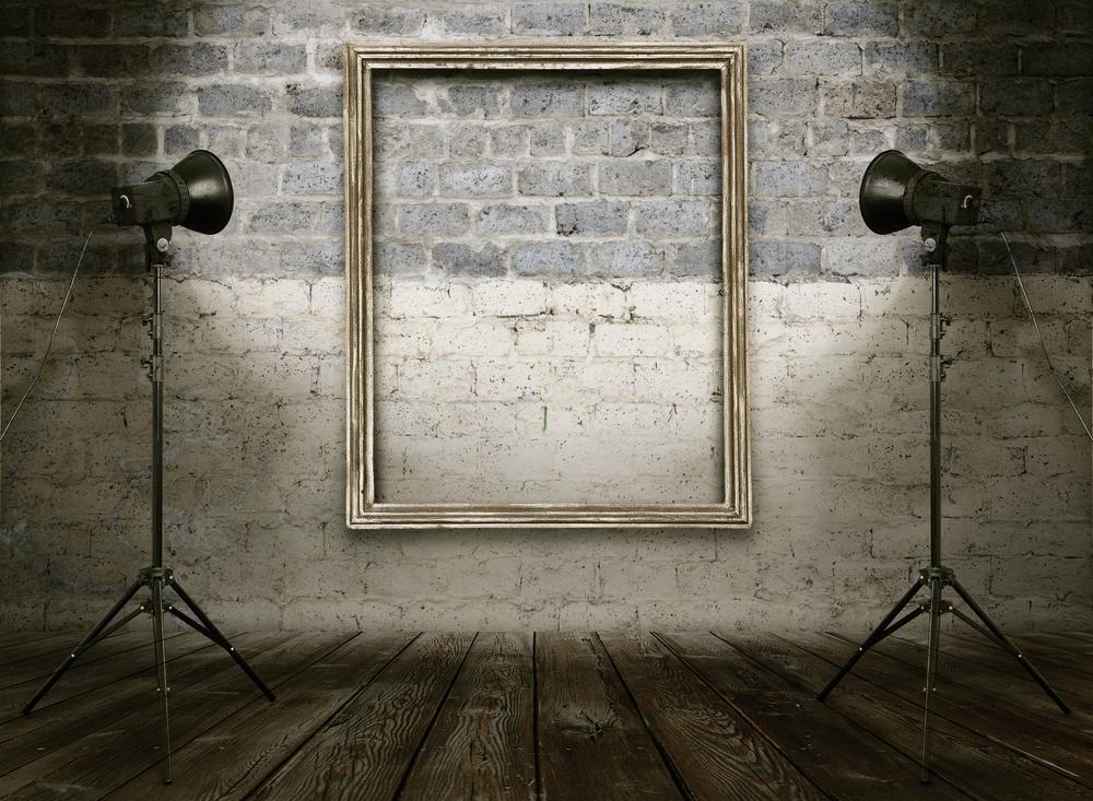 Lamps light an empty frame.