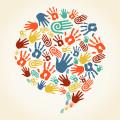 Colorful handprints on an ecru background.