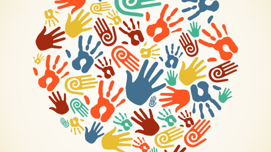 Colorful handprints on an ecru background.