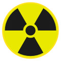 A red and yellow artistic rendition of the radioactivity symbol.
