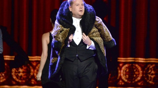 James Corden hosts the event in a bright outfit.