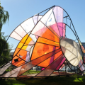 A photo of a colorful sculpture in the park.