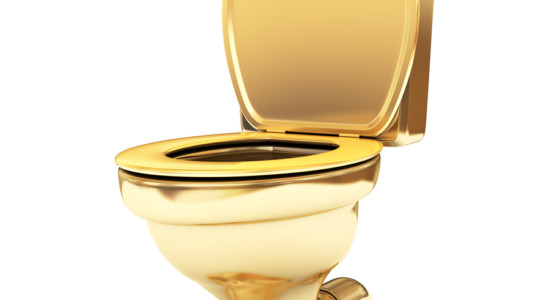 An image of a gold toilet.