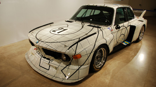 A BMW painted in a strange, square pattern.