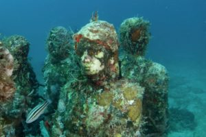 A photo of underwater statues.