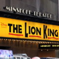 An advertisement for The Lion King musical shown outside of the Minskoff Theatre in New York City.