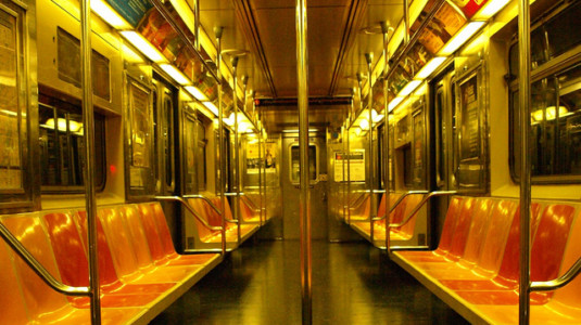 A photo of an empty New York City subway car.