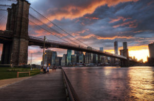 The Manhattan Bridge shown at sunset.