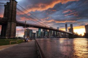 The Manhattan Bridge shown at sunset.