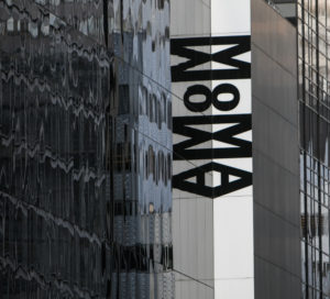 A photo taken from the outside of the Museum of Modern Art located in New York, NY.