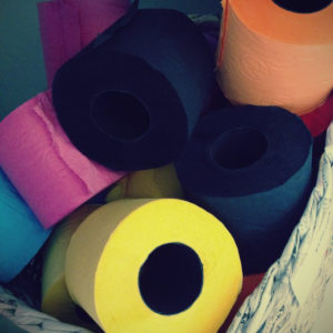 A photo of colorful rolls of toilet paper.