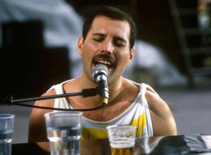 A picture of Freddie Mercury singing.