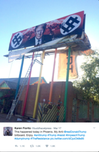 A picture of an anti-Trump billboard taken from Karen Fiorito's Twitter account.