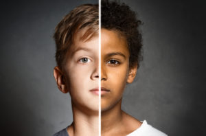 Two school-aged boys—one black, one white.