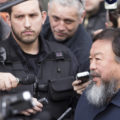 A photo of Chinese artist Ai WeiWei taking questions from the press.