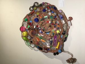 "An artwork made from recycled materials. The piece is titled, ""Gyre"" and was created by Julie Kornblum."