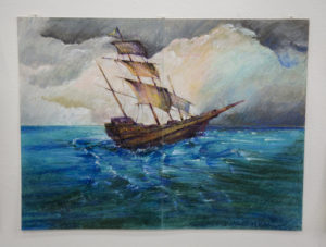 A painting of a ship at sea. The artist is Ghaleb al-Bihani, a former Guantanamo prisoner who was released in January 2017.