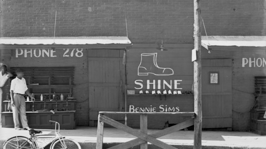A photo of a shoeshine stand taken in the Southeastern U.S. in 1936. The image was captured by photographer Walker Evans.