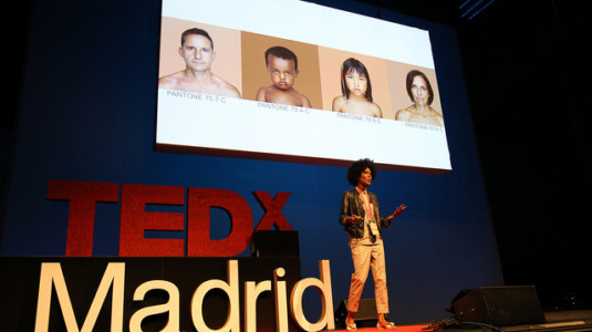 "Artist Angelica Dass speaks about her project ""Humanæ"" at a TedX event in Madrid, Spain."