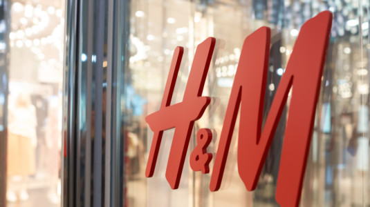 A photo taken from the outside of an H&M store. The clothing retailer was recently sued for using a graffiti artist's work without his permission.