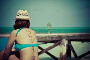 Girl with tattoo on beach
