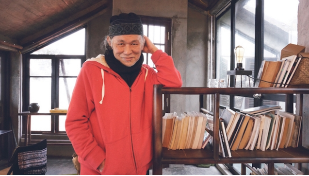 Nguyen Qui Duc at his home.