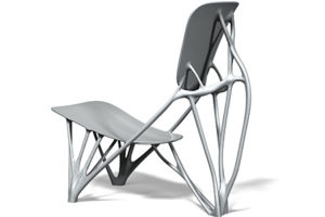 """A unique chair that appears to be made from bones. It's called """"Bone Chair"""" and was designed by Joris Laarman."""
