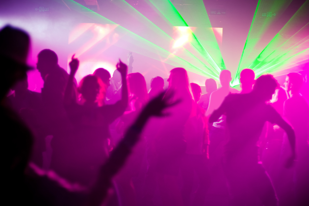 A photo of people dancing at a club.