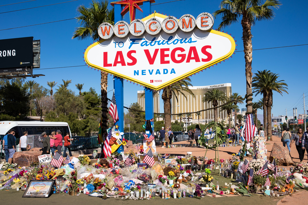 "Flowers, cards, and other gifts placed beneath the ""Welcome to fabulous Las Vegas"" sign in honor of those who lost their lives in the Route 91 Harvest country music festival shooting."