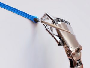 A robotic hand using a paint brush.