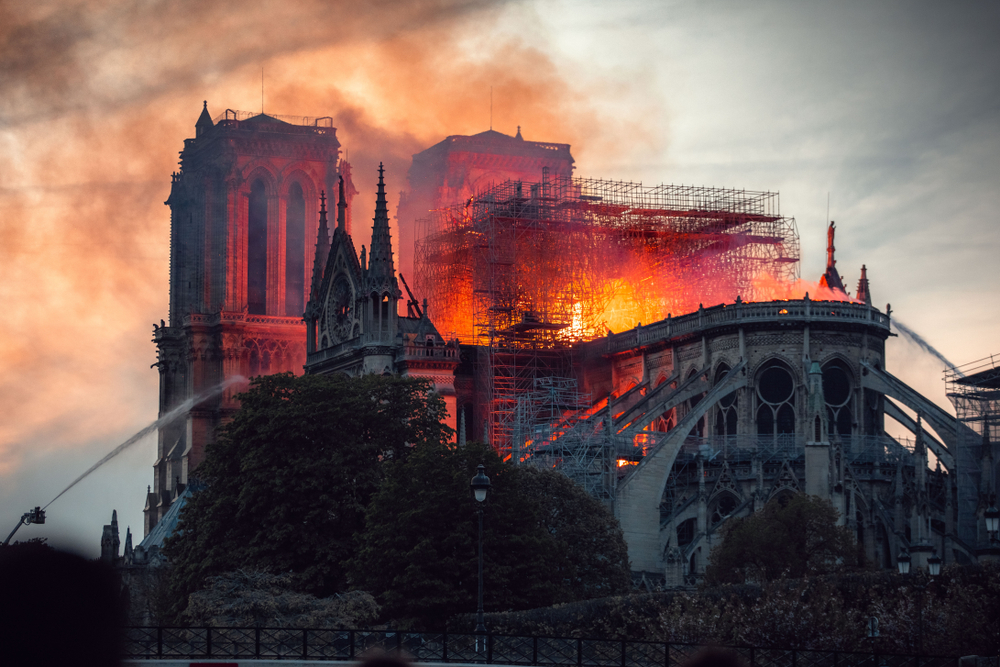 A photo of the Notre Dame cathedral on fire.